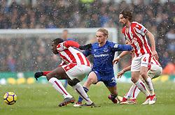 Everton's Tom Davies (centre) battles for the ball with Stoke City's Joe Allen (right) and Kurt Zouma