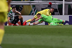 February 14, 2019 - Lisbon, Portugal - Sporting's goalkeeper Romain Salin from France (R ) vies with Villarreal's midfielder Pablo Fornals during the UEFA Europa League Round of 32 First Leg football match Sporting CP vs Villarreal CF at Alvalade stadium in Lisbon, Portugal on February 14, 2019. (Credit Image: © Pedro Fiuza/NurPhoto via ZUMA Press)