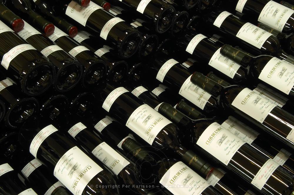 Bottles aging in the cellar. Clos de l'Obac, Costers del Siurana, Gratallops, Priorato, Catalonia, Spain.