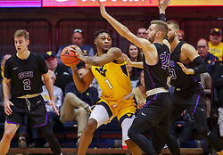 Mar 20, 2019; Morgantown, WV, USA; West Virginia Mountaineers forward Derek Culver (1) attempts to pass the ball during the first half against the Grand Canyon Antelopes at WVU Coliseum. Mandatory Credit: Ben Queen