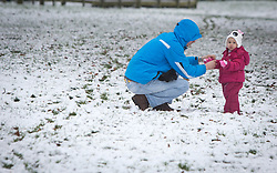 © Licensed to London News Pictures 14/01/2013.  Kenilworth, Warwickshire.   A father and his daughter play in the snow in Kenilworth this morning.  The week is expected to bring freezing temperatures and snow across the UK.  Photo credit : Alison Baskerville/LNP