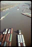 Aerial downstream view of barges stacked up below Lock & Dam #26 (not pictured);Mississippi River Missouri