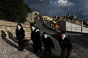 Nuns walk up the entrance of a church at the start of a religious ceremony held every year to bless shepherds who would, at the beginning of the winter, walk with their herds to the south of Italy for warmer weather, Castel del Monte, in the province of L'Aquila in Abruzzo.