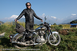 Grant Peterson poses with a spectacular background of 23,000' peaks on day-4 our our Himalayan Heroes adventure riding from Pokhara to Kalopani, Nepal. Friday, November 9, 2018. Photography ©2018 Michael Lichter.