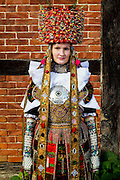 Marie, member of a Schaumburg-Lippisch Folklore Association is wearing an original traditional bridal costume in Bad Nenndorf, Lower Saxony, Germany on October 23, 2016.<br /> <br /> The bridal dress has it's origins in Spanish Fashion of the second half of the 1600s and is from the early 1900s. Only pristine women were allowed to wear the bridal crown.<br /> <br /> This is part of the series about Traditional Wedding Gowns from different regions of Germany, worn by young members of local dance groups and cultural associations that exist to preserve and celebrate the cultural heritage. The portraiture series is a depiction of an old era with different social values and religious beliefs in an antiquated civil society with very few of those dresses left.