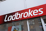 Sign for the bookemakers and gambling brand Ladbrokes on 24th March 2021 in Birmingham, United Kingdom.