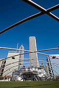 View through the trellis structure in front of the Frank Gehry-designed Jay Pritzker Pavilion in Millennium Park, Chicago, Il. USA. And downtown cityscape.