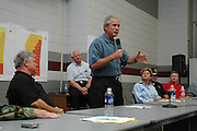 President Bush joins Governor of Mississippi Haley Barbou,left seated, at Pearl River Community College in Poplarville,Ms Monday Sept. 5,2005. Gathered atthe colleg are elected official from around the stae of Mississippi and law emforcement personnel affected Katrina. They are all ther for answers and help.Hurricane Katrina is the worst natural disaster to hit American soil and the National and local goverments are working together to clean up the mess from the catasrophic destruction. (Photo/Suzi Altman)