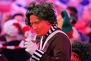 A rather cheerful looking fan in fancy dress, Oompa Loompa, during the World Championship Darts 2018 at Alexandra Palace, London, United Kingdom on 17 December 2018.