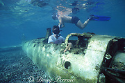 snorkelers and WWII Japanese Zero figher plane wrecked in lagoon, Palau (Belau), Micronesia ( Western Pacific Ocean )