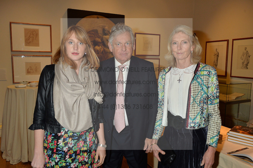 LONDON, ENGLAND 28 NOVEMBER 2016: Left to right, Octavia Dickinson, Simon Dickinson and Jacqui Dickinson at a reception to celebrate the publication of The Sovereign Artist by Christopher Le Brun and Wolf Burchard held at the Royal Academy of Art, Piccadilly, London, England. 28 November 2016.