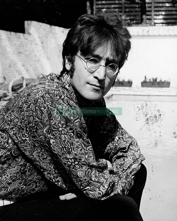 July 24, 1968 - London, England, United Kingdom - Singer/Songwriter JOHN LENNON (1940-1980) member of The Beatles relaxing at his home. Today marks the 25th anniversary of the death of JOHN WINSTON LENNON. He was born on Oct. 9th, 1940 in Liverpool and was best known as a singer, songwriter, poet and guitarist for The Beatles. He is recognized as one of the greatest musical icons of the 20th century. On the evening of Dec. 8th, 1980, in New York City, deranged fan Mark David Chapman shot Lennon 4 times in the back and shoulder. Despite extensive resuscitative efforts, Lennon died of shock and blood loss at the age of 40..(Credit Image: © Keystone Press Agency/Keystone USA via ZUMAPRESS.com)