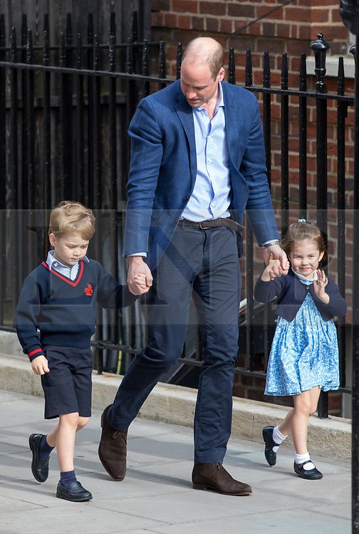 © Licensed to London News Pictures. 23/04/2018. London, UK. The Duke of Cambridge arrives at the Lindo Wing of St Mary's Hospital in west London with his son Prince George of Cambridge and daughter Princess Charlotte of Cambridge. The Duchess of Cambridge has given birth to her third son, safely delivered at 11:01 AM today. He weighed 8lbs 7oz and is fifth in line to the throne. Photo credit : Tom Nicholson/LNP