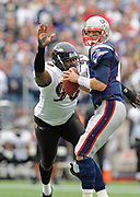 Oct 4, 2009, Foxborough, Massachusetts, USA;  Trevor Pryce of the Baltimore Ravens looks to strip the football out of the hands of Tom Brady of the New England Patriots as the Patriots defeated the Ravens 27-21.
