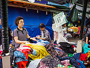 08 JUNE 2018 - SEOUL, SOUTH KOREA: Women shop for clothes in Namdaemun Market. Namdaemun Market is one of the oldest continually running markets in South Korea, and one of the largest retail markets in Seoul.[6] The streets in which the market is located were built in a time when cars were not prevalent, so the market itself is not accessible by car. The main methods of transporting goods into and out of the market are by motorcycle and hand-drawn carts. It occupies many city blocks, which are blocked off from most car traffic due to the prevalence of parking congestion in the area.    PHOTO BY JACK KURTZ