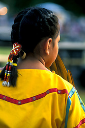 Stock photo of the back of a young girl with decorated braids