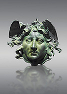 Roman decoration panel of Medusa from a Roman ship, the age of Calligula, 37-41 AD, made from bronze. The head of the medusa is an example of refined craftsmanship. The detail of the hair, the scales, the snakes and the nostrils were made using hand held tools . the work is at its most frightening when viewed from a low anyle suggesting that it was designed to be places high up on the ship .  The National Roman Museum, Rome, Italy