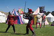 McG0064278<br /> Re-enactors perform at Portchester Castle in Hampshire to mark the 600th anniversary of the battle of Agincourt. <br /> In 1415 soldiers left from the castle, now managed by English Heritage, for northern France where they went on to face the French in a muddy farmer's field.<br /> Picture date: Saturday August 8, 2015.<br /> Photograph by Christopher Ison ©<br /> 07544044177<br /> chris@christopherison.com<br /> www.christopherison.com