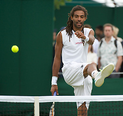 24.06.2011, Wimbledon, London, GBR, Wimbledon Tennis Championships, im Bild Dustin Brown (GER) in action during the Mixed Doubles 1st Round match on day five of the Wimbledon Lawn Tennis Championships at the All England Lawn Tennis and Croquet Club, EXPA Pictures © 2011, PhotoCredit: EXPA/ Propaganda/ *** ATTENTION *** UK OUT!