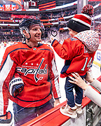 Washington Capitals forward Richard Panik shares a moment with his daughter before his team faces the San Jose Sharks on January 5, 2020.