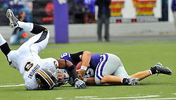 Nov 14, 2009; Manhattan, KS, USA; Missouri defender Jasper Simmons (9) makes the tackle on Kansas State quarterback Grant Gregory (6) in the first half at Bill Snyder Family Stadium. The Tigers won 38-12. Mandatory Credit: Denny Medley-US PRESSWIRE