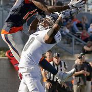 Orange Coast College wide receiver James Rutledge rises up over Fullerton College's Tim Gordon in the second half of Fullerton's 35-14 win on November 5, 2016.