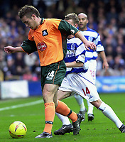 Picture: Raymond Field<br /><br />Queens Park Rangers v Plymouth Argyle nationwide league division two<br /><br />15/11/2003<br /><br />Peter Gilbert keeping Martin Rowland at bay