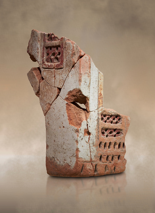 Hittite terra cotta fragmants of a defenive wall tower shaped vessel . Hittite Period, 1600 - 1200 BC.  Hattusa Boğazkale. Çorum Archaeological Museum, Corum, Turkey. Against a warm art bacground. .<br />  <br /> If you prefer to buy from our ALAMY STOCK LIBRARY page at https://www.alamy.com/portfolio/paul-williams-funkystock/hittite-art-antiquities.html  - Type Hattusa into the LOWER SEARCH WITHIN GALLERY box. Refine search by adding background colour, place,etc<br /> <br /> Visit our HITTITE PHOTO COLLECTIONS for more photos to download or buy as wall art prints https://funkystock.photoshelter.com/gallery-collection/The-Hittites-Art-Artefacts-Antiquities-Historic-Sites-Pictures-Images-of/C0000NUBSMhSc3Oo