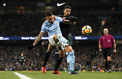 """Manchester City's Nicolas Otamendi (left) and West Ham United's Manuel Lanzini (right) battle for the ball during the Premier League match at the Etihad Stadium, Manchester. PRESS ASSOCIATION Photo. Picture date: Sunday December 3, 2017. See PA story SOCCER Man City. Photo credit should read: Martin Rickett/PA Wire. RESTRICTIONS: EDITORIAL USE ONLY No use with unauthorised audio, video, data, fixture lists, club/league logos or """"live"""" services. Online in-match use limited to 75 images, no video emulation. No use in betting, games or single club/league/player publications."""