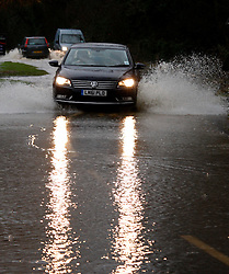 © Licensed to London News Pictures. 20/12/2012. Grendon, North Warwickshire. Spon Lane, Grendon is flooded as cars try to pass through a waterlogged road. Photo credit : Dave Warren/LNP
