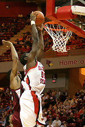 01 January 2006..Greg Dilligard is fed the ball on a fast break and slams it home in an attempt to make a statement and get the crowd into the game...The Southern Illinois Saluki's chewed up the Illinois State Redbirds with 37 points in the 2nd half to beat the birds with a final score of 65-52.  An audience of just over 7500 watched the in Redbird Arena on the campus of Illinois State University in Normal Illinois.....