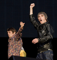© Licensed to London News Pictures . FILE PICTURE DATED 30/06/2012. Manchester, UK. The Stone Roses are to headline at the 2013 Isle of Wight Festival organisers have announced today (26th November 2012). Pictured: Ian Brown (right) and Mani (left) ( Gary Manny Mounfield ), perform at Heaton Park in Manchester , for their Second Coming event in June 2012 .  Photo credit : Joel Goodman/LNP
