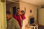 Omar (red jacket) walks into his apartment in Bergen, Norway. Nader has filled it with candles in a heart shape, with the letters O and N in the middle.