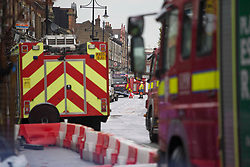Licensed to London News Pictures. 21/10/2020. London, UK. Police and London Fire Brigade guard a scene after the blast that is believed to have happened on King Street in Ealing, west London around 6:20am this morning. Photo credit: Marcin Nowak/LNP
