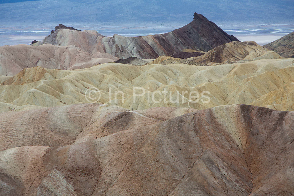 Zabriskie Point is a part of Amargosa Range located in Death Valley National Park in California, noted for its erosional landscape and being one of the worlds hottest places. The location was named after Christian Brevoort Zabriskie, vice-president and general manager of the Pacific Coast Borax Company in the early 20th century. The company's twenty-mule teams were used to transport borax from its mining operations in Death Valley.