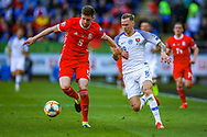 Wales defender Chris Mepham tussles with Slovakia midfielder Ondrej Duda during the UEFA European 2020 Qualifier match between Wales and Slovakia at the Cardiff City Stadium, Cardiff, Wales on 24 March 2019.