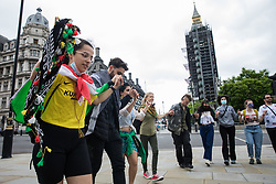London, UK. 3rd July, 2021. Members of the Kurdish community and supporters dance in Parliament Square during a Defend Kurdistan demonstration. Defend Kurdistan is an international initiative begun in June 2021 calling for a halt to Turkish attacks on, and the withdrawal of all Turkish troops and Islamist mercenaries from, South Kurdistan. Similar demonstrations took place in other cities around the world.