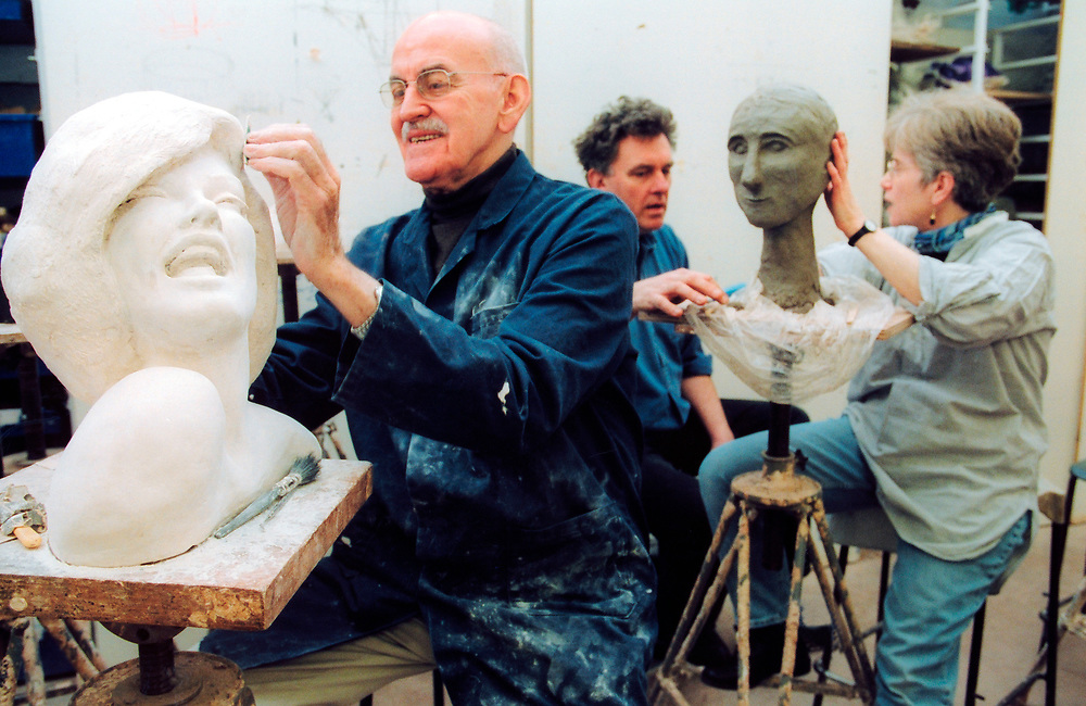 Students in adult education art class London UK