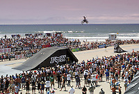 30 July 2006: FMX Freestyle Motocross Moto X rider Jeff Tilton, 30 of San Diego in action doing tricks and catching big air on the 75' ramp on the final day of the 2006 Bank of the West Beach Games in Surf City Huntington Beach in Orange County Southern California, CA. Pacific Ocean serves as a backdrop behind the riders who perform for a few thousand fans on Sunday.