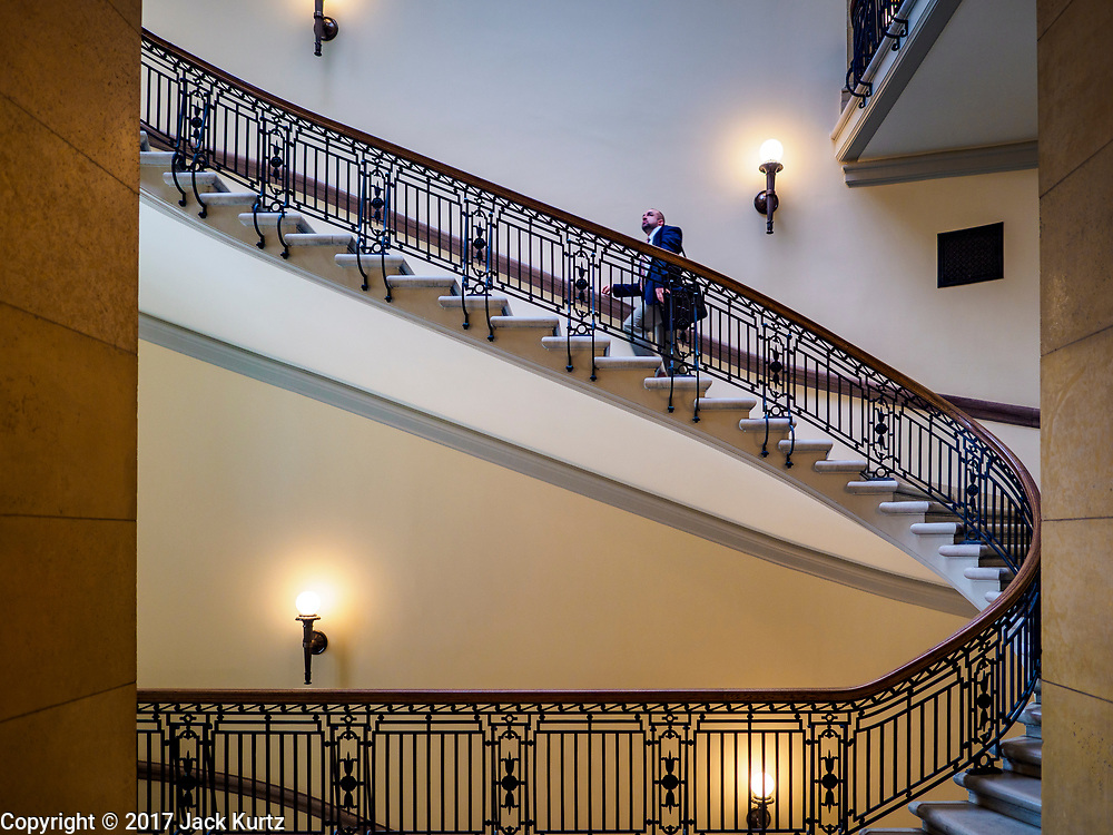 01 MAY 2017 - ST. PAUL, MN: A man walks up the stairs in the Minnesota State Capitol in St. Paul.     PHOTO BY JACK KURTZ