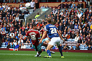 Lukas Jutkiewicz of Burnley sees his shot blocked by Michael Morrison of Birmingham City. Skybet football league championship match, Burnley  v Birmingham City at Turf Moor in Burnley, Lancs on Saturday 15th August 2015.<br /> pic by Chris Stading, Andrew Orchard sports photography.