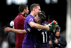 Arsenal's Lucas Torreira (right) and Bernd Leno celebrate after the Premier League match at Craven Cottage, London.