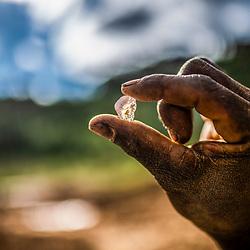 Fea0093883. DT News.Tananarive a mining village near AMBATONDRAZAKA,The Ankeniheny-Zahamena Corridor, Madagascar.Pic Shows A miner shows off what he claims is a sapphire  in the village of Tananarive
