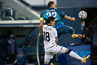 SAINT-PETERSBURG, RUSSIA - OCTOBER 20: Federico Ricca Club Brugge KV tussles with Artem Dzyuba of Zenit St Petersburg during the UEFA Champions League Group F match between Zenit St Petersburg and Club Brugge KV at Gazprom Arena on October 20, 2020 in Saint-Petersburg, Russia [Photo by MB Media]