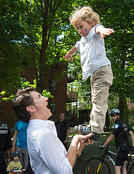 Prime Minister Justin Trudeau balances his son Hadrian at a street party for the Fete National du Quebec, Saturday, June 24, 2017 in Montreal, Canada. Photo by Paul Chiasson/CP/ABACAPRESS.COM