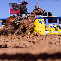 Autumnrain Chee rounds her second barrel on her way to a 17.74 second finish during the Navajo Nation Fair rodeo in Window Rock Saturday.