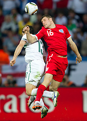 Bojan Jokic of Slovenia vs James Milner of England during the 2010 FIFA World Cup South Africa Group C Third Round match between Slovenia and England on June 23, 2010 at Nelson Mandela Bay Stadium, Port Elizabeth, South Africa. England defeated Slovenia 1-0 and qualified for the next round, Slovenia not. (Photo by Vid Ponikvar / Sportida)