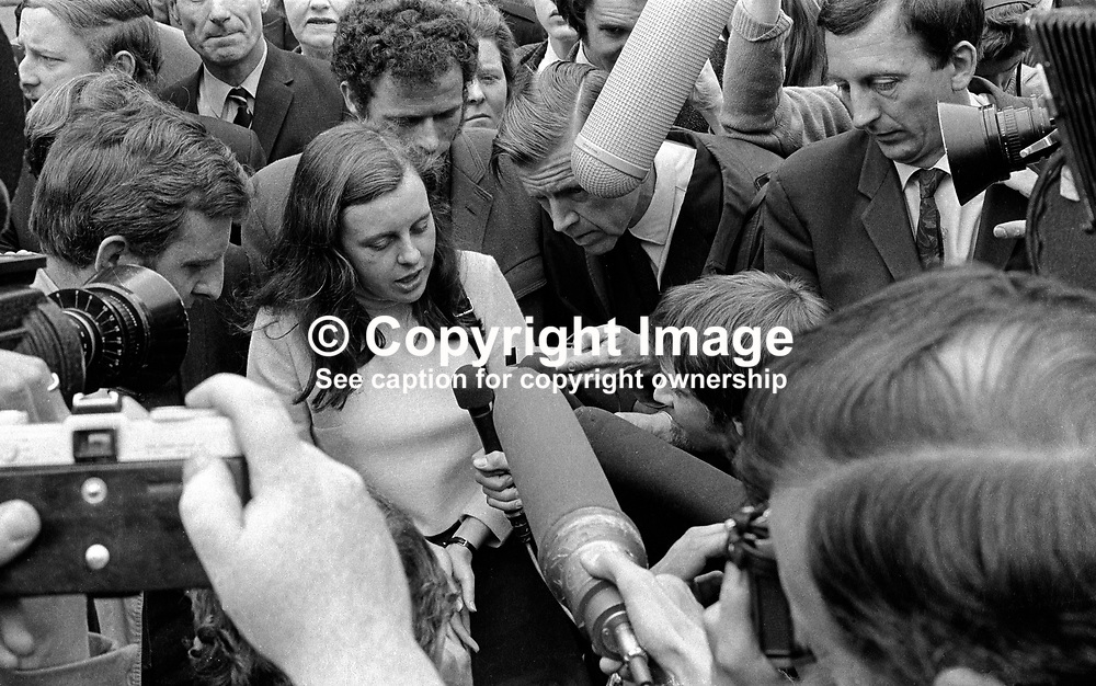 Bernadette Devlin, MP, in a media scrum outside the N Ireland High Court, after being refused leave to appeal to the Lords against a 6 months jail sentence for her part in rioting in the Bogside in Londonderry. 197006260236.<br /> <br /> Copyright Image from Victor Patterson, Belfast, UK<br /> <br /> t: +44 28 9066 1296 (from Rep of Ireland 048 9066 1296)<br /> m: +44 7802 353836<br /> e: victorpattersonbelfast@gmail.com<br /> <br /> www.images4media.com<br /> <br /> Please see my full Terms and Conditions of Use at https://www.images4media.com/p/terms-conditions - it is IMPORTANT that you familiarise yourself with them.<br /> <br /> Images used online incur an additional cost. This cost should be agreed in writing in advance. Online images must be visibly watermarked i.e. © Victor Patterson or that of the named photographer within the body of the image. The original metadata must not be deleted from images used online.<br /> <br /> This image is only available for the use of the download recipient i.e. television station, newspaper, magazine, book publisher, etc, and must not be passed on to a third party. It is also downloaded on condition that each and every usage is notified within 7 days to victorpattersonbelfast@gmail.com.