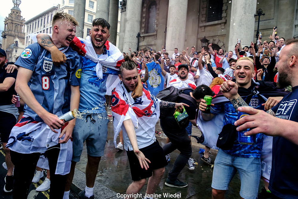 English Football fans throwing beer on each other in central London before the finals of football match against Italy.  England v Italy Euro 2020 final. 11 July 2021