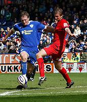 Photo: Steve Bond/Richard Lane Photography. <br />Leicester City v Colchester United. Coca Cola Championship. 12/04/2008. Steve Howard (L) is challanged by Matt Heath (R)